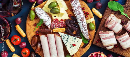 Italian antipasti wine snacks set, prosciutto,cheese, olives, grapes, sausage and cold meat Canvas Print