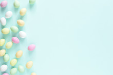 Colored Easter Candy Eggs On Turquoise Background. Easter Minimal Card.