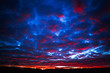 canvas print picture Gorgeous colorful sunset on cloudy blue sky in field and forests, beauty in nature