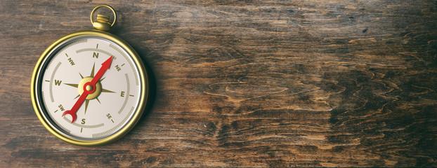 Compass instrument against wooden background. 3d illustration