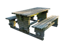 An Old Picnic Table Made Of Logs