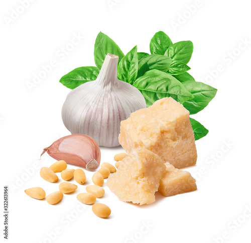 Fotografia Fresh pesto ingredients, green basil, garlic clove, parmesan cheese and pine nut
