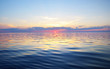 Colorful sunset sky above the Baltic sea, Latvia. Sunlight through the clouds, reflections on the water