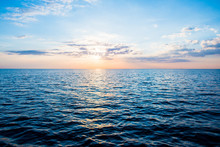 Panoramic View Of The Baltic Sea At Sunset. Latvia. Clear Sky, Glowing Clouds, Reflections On Water. Blue, Pink, Orange Colors. Nature, Seasons, Travel Destinations, Cruise. Idyllic Seascape