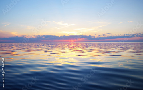 Fototapeta Colorful sunset sky above the Baltic sea, Latvia. Sunlight through the clouds, reflections on the water obraz