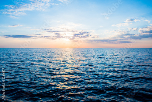 Obraz Colorful sunset sky above the Baltic sea, Latvia. Sunlight through the clouds, reflections on the water - fototapety do salonu