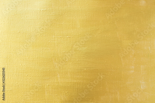 Background-rough art canvas painted with gold paint close-up with copy space Canvas Print