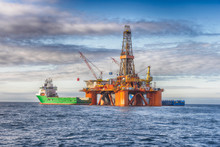 Supply Vessel During Operation Along Side With A Drilling Rig