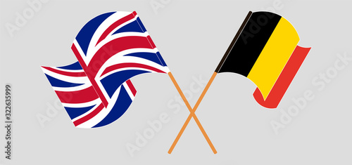 Photo Crossed and waving flags of Belgium and the UK