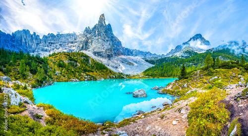 Fototapeta Famous turquoise lake Sorapis with high mountains at sunset, Dolomites, Italy, Europe obraz