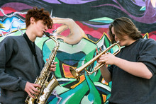 Teenage Boys Playing Saxophone...
