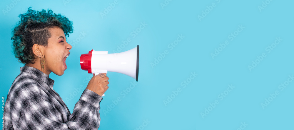 Fototapeta african american girl or woman with megaphone isolated on blue background