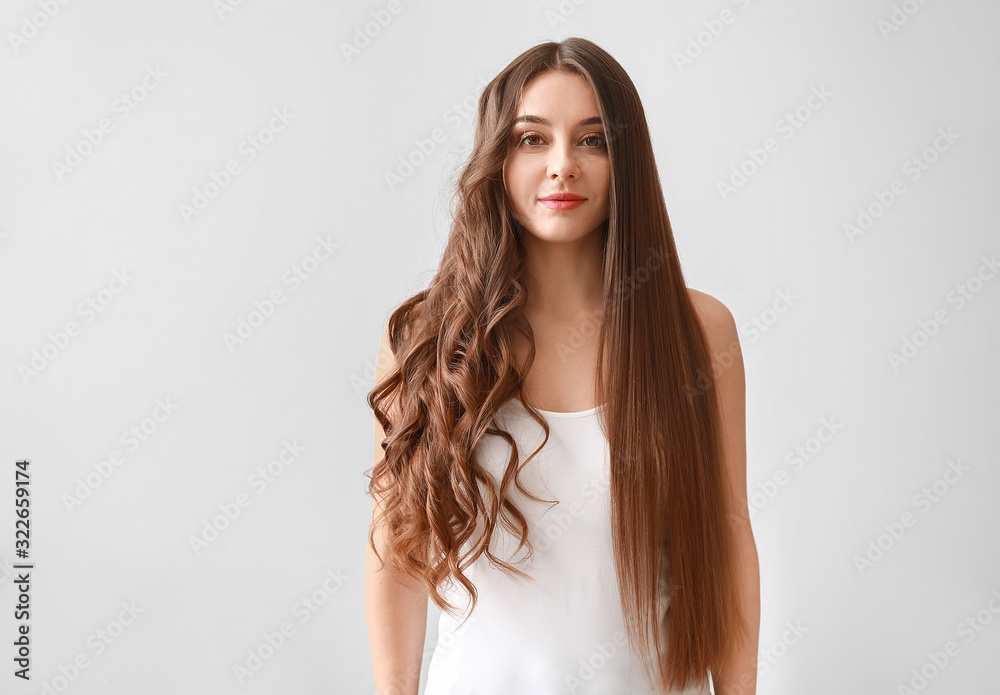 Fototapeta Beautiful woman with curly and smooth hair on white background