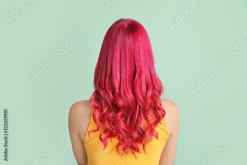 Canvas Print Beautiful young woman with unusual hair on color background
