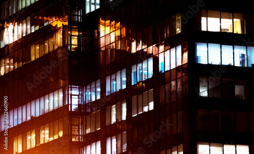 Office building exterior in the late evening with interior lights on Canvas Print