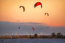 Kite Surfers At Neusiedl Lake In Podersdorf, Austria At Sunset