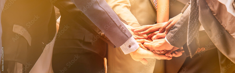 Fototapeta Creative team meeting hands together synergy brainstorm business man woman, asian people teamwork acquisition, business people concept. Startup friends creative people sale project panoramic banner