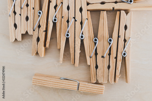 Fotografie, Obraz group of wooden peg to hang the washing, sustainable living and alternative to p