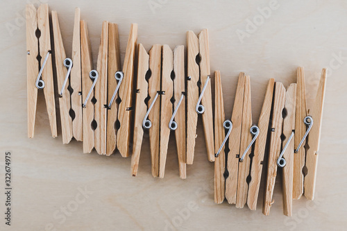 group of wooden peg to hang the washing, sustainable living and alternative to p Wallpaper Mural