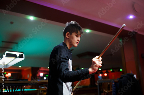 Boy plays billiard or pool in club Wallpaper Mural