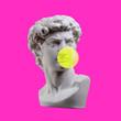canvas print picture - Statue isolated. Gypsum statue of David's head. Man. Creative. Plaster statue of David's head with bubble gum . Minimal concept art.