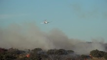 Large Aircraft Dropping Phoscheck On California Wildfire