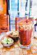 Michelada beer with Tomato Juice, lemon and candy in jar, Mexican drink in summer in Mexico