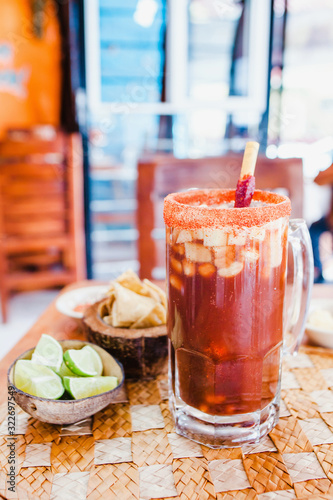 Obraz na plátně Michelada beer with Tomato Juice, lemon and candy in jar, Mexican drink in summe