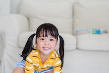 Happy Little Asian Toddler Gir...