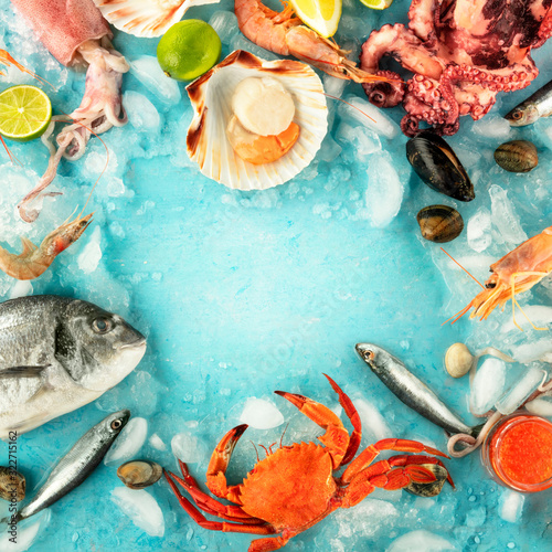 Fotografija Fish and seafood square frame with a place for text on a blue background