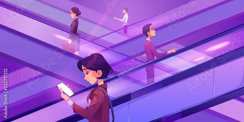 Fotografía People on escalators in mall