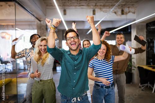 Fototapeta Happy business people celebrating success at company obraz