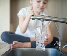 Little Girl Opens A Water Tap ...