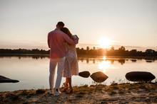 Couple Hugging At Sunset. Beau...