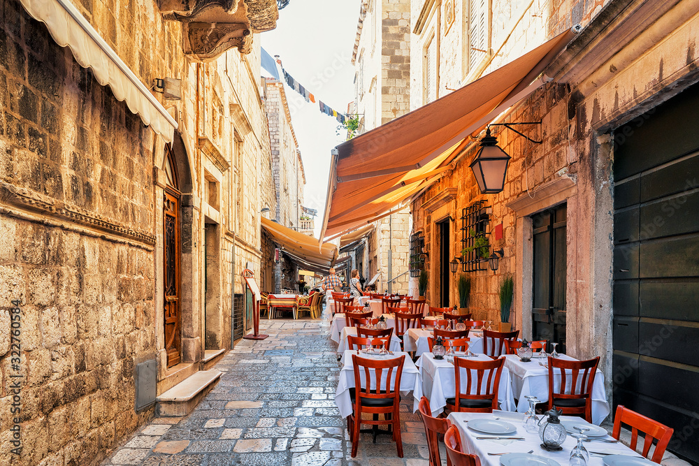 Fototapeta Open Street terrace cafe in Dubrovnik