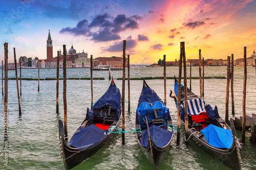 Venetian gondolas at the harbor and San Giorgio Maggiore island at sunset, Venice Wallpaper Mural