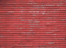 Close Up On Red Barn Faded Red Wood Siding.