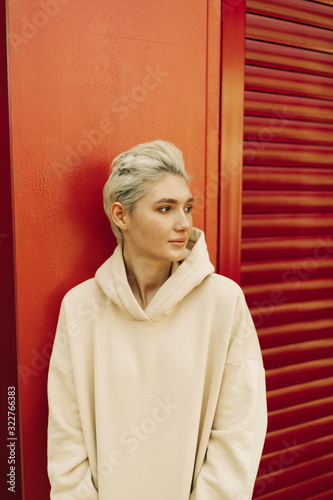 Blond young woman  with short hair #322766383