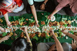 canvas print picture - Top View portrait of people asian eating their food served on top of banana leaf lay on the floor. kembulan javanese eating tradition