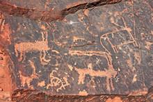 Ancient Graffiti On Red Rocks In The Jordanian Desert Of Wadi Rum.