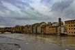 Ponte Vecchio over the Arno River surrounded by buildings in Florence in Italy