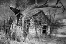 Grayscale Shot Of An Abandoned Farmhouse