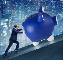 Man Pushing Piggybank Uphill I...