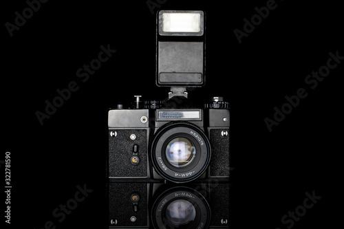 Obraz One whole camera with flash isolated on black glass - fototapety do salonu
