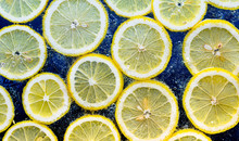 Lemon Slices In The Water With...