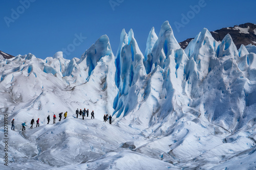 Obraz na plátně Tourists Trekking on Perito Moreno Glacier in Los Glaciares National Park Near E