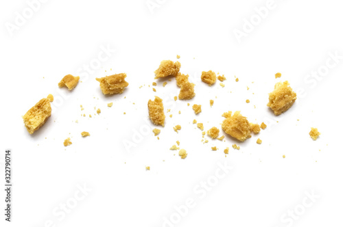 Scattered crumbs of butter cookies on white background. Canvas Print
