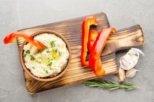 Flat Lay View At Vegetable Hummus Dip Dish Topped With Olive Oil Served With Red Sweet Bell Pepper Slices