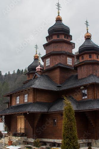 Old wooden building of the Holy Prophet Elijah Monastery in the Carpathian village of Yaremche in winter Wallpaper Mural