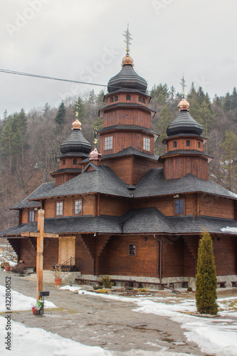 Old wooden building of the Holy Prophet Elijah Monastery in the Carpathian village of Yaremche in winter Canvas Print